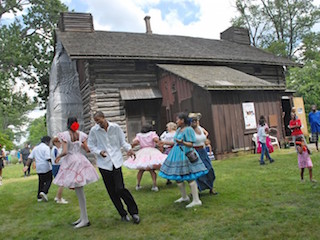 Group aims to raise $25K to restore historic Palmer Park log cabin